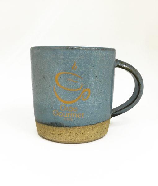 caneca de cerâmica azul claro
